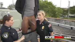 Three nympho cops with big ass devore a big black pecker