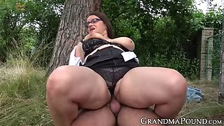Busty mature lady with glasses reverse cowgirl rides cock