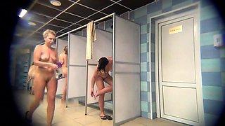 Voyeur spying on amateur Russian ladies in the shower