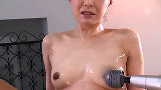 Pleasing asian MILF is fingering her tight cunt