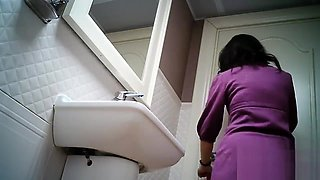 Women pee in public toilet 2259