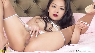 Asian babe masturbates tight wet pussy in stockings heels
