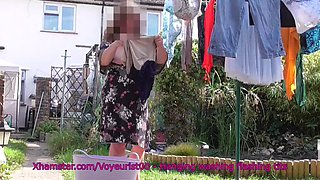 Hanging washing wearing exposed tits dress