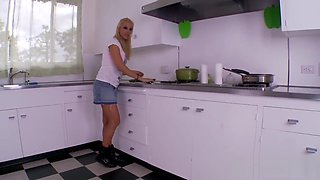 Two sexy lesbians fuck each in the kitchen with cucumber