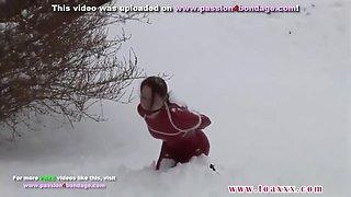 Bondage girl in snow