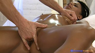 Ebony babe demolished by the masseur's massive dong
