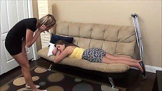 Katie in a crutch sleeping tickle