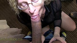 Mature blonde fucking a big black cock