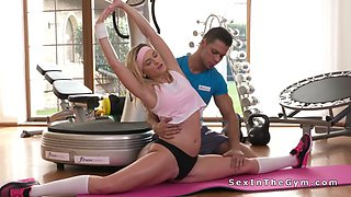Flexible blonde fucks at the gym