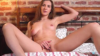 Hot alone buxom chick Milana M just enjoys teasing her bald pussy