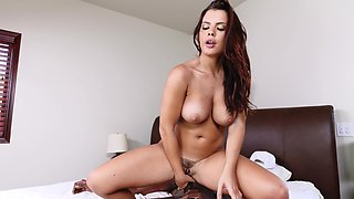 A big ass young woman is getting anally fucked by a black cock