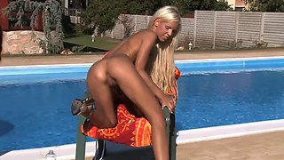 Two hot girls playing by the pool with everything in soght