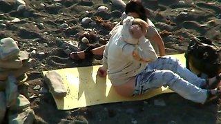Couple on beach voyeur filming