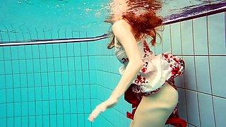 Hot Polish redhead swimming in the pool