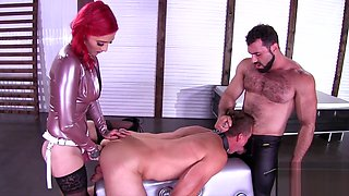 Master and mistress in thigh high boots dominate their slave
