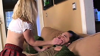 Attractive playgirl dominates a lad by sitting on his face