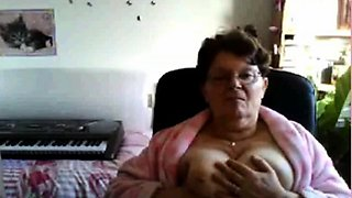 naughty granny flashing her big tits on cam