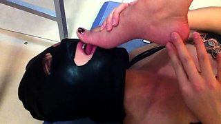 Dominant brunette with wonderful legs gets her toes licked