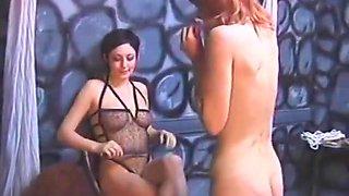 Dark haired slut dominates two sluts