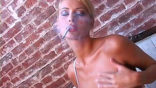 Zdenka Podkapova smokes a cigarette in a sexy style