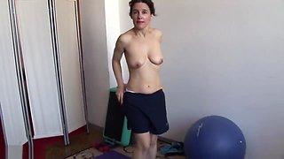 Mature yoga lover enjoys a flexible masturbation