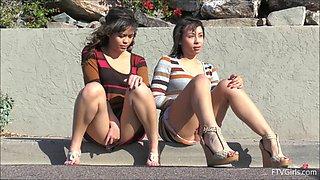 Girls outdoors having fun with upskirt flashing