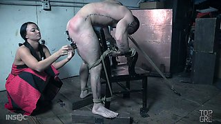 Perverted mistress London River punishes balls and dick of one kinky tied up man