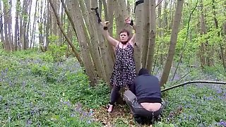 Titless mature slut stripped and exposed in the woods