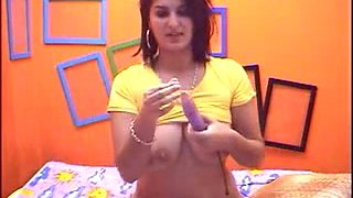 Pregnant brunette with dildo