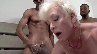 Blonde Granny enjoys double penetration during an Interracial Gangbang