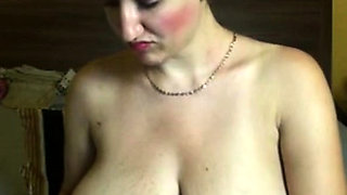 Natural huge hanging tits on MILF