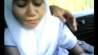petite malay girl giving bj in a car