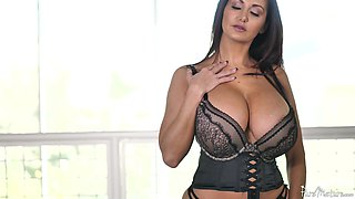 Stunning Ava Addams uses her oiled up tits to make a dick stiff
