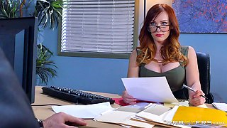 Redhead knows how to satisfy her boss by using her pussy
