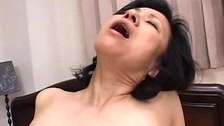 Mature Asian mom sucking a hot young cock hard
