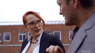 Tempting redheaded secretary fucks a hot girl in stockings