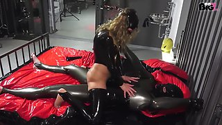 Couple sex on the bed in latex