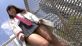Slutty and horny asian chick walks outside in short dress