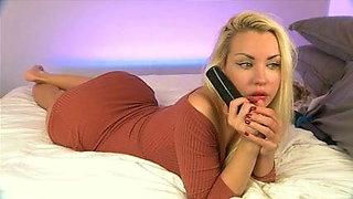 Blonde babe talking on phone