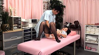 Wild Asian babes enjoy strong orgasms on the massage table
