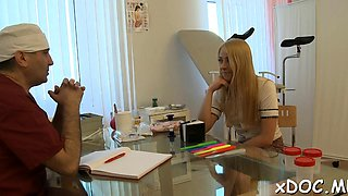 Hot teen honey and her gracious doctor are making love