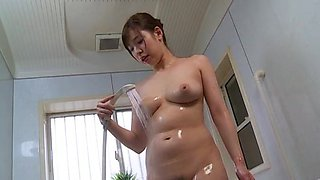 Japanese wife plays with the shower on her wet cunt