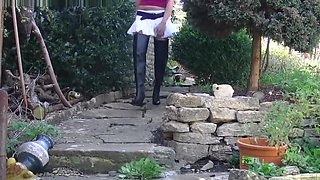 Hot smoking blonde lets you upskirt pussy in leather boots