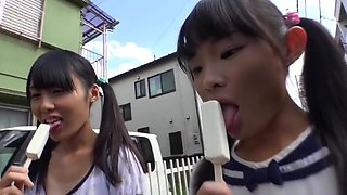 Tiny japanese schoolgirl eating ice cream