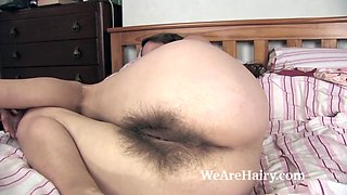 Josie gets naked in bed and masturbates with a toy