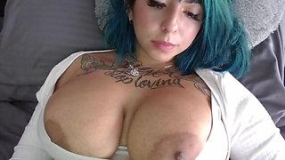 Busty tattooed Kitty sucks nipples and titfucks dildo