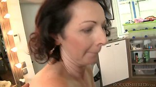 Elegant granny is riding dick in the kitchen