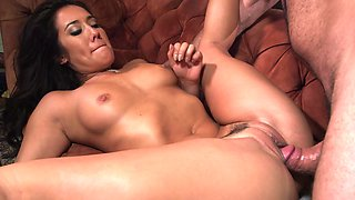 Hot brunette with sizable tits is fucked in her tight pussy