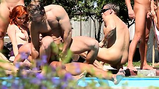 Lustful bisexual couples enjoying wild group sex by the pool