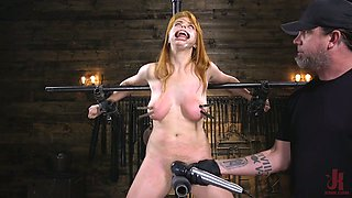 Red haired juggy porn model Penny Pax gets punished in the BDSM room